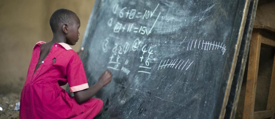 Masai_girl_at_school_doing_maths